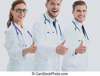 Portrait of an assertive medical team against a white background