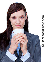 Portrait of an attractive businesswoman drinking a coffee