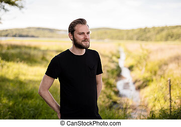 Portrait of an attractive man outdoors in the summer
