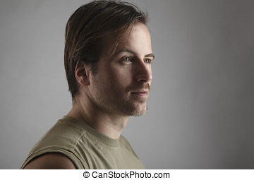 Portrait of an attractive man with green shirt