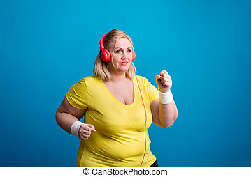 Portrait of an attractive overweight woman in studio on a...