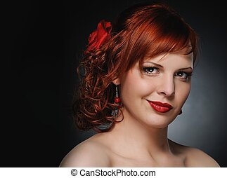 Portrait of an attractive redhead woman