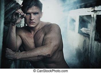 Portrait of an attractive strongman