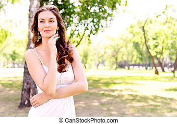 Portrait of an attractive woman in the park