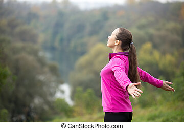 Portrait of an attractive woman outdoors in a sportswear