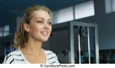 Portrait of an attractive woman who is trained in the gym