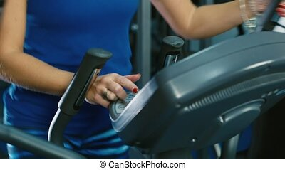 Portrait of an attractive woman who trains in the gym