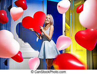 Portrait of an attractive woman with bunch of balloons