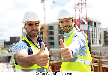 Portrait of an attractive worker and an architect on a construction site