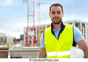 Portrait of an attractive worker on a construction site