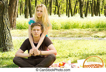 Portrait of an attractive young couple on picnic