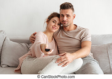 Portrait of an attractive young couple sitting on a couch
