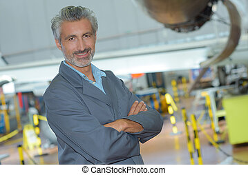 portrait of an aviation engineer in a hangar