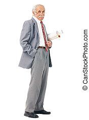 Portrait of an elder artist with paper rolls