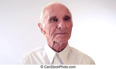 portrait of an elderly man on a white background