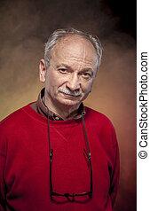 Portrait of an elderly man wearing red jacket