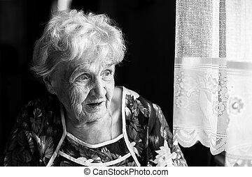 Portrait of an elderly woman closeup.