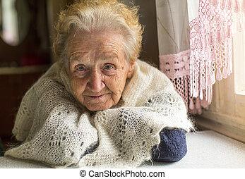 elderly woman near the window