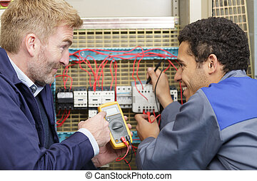 portrait of an electricians at work
