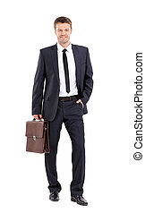 Portrait of an elegant handsome business man with  suitcase on w