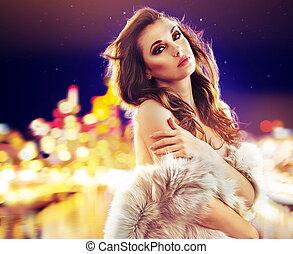 Portrait of an elegant lady wearing fur coat