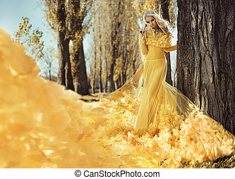 Portrait of an elegant woman walking in the autumnal park