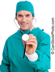 Portrait of an enthusiastic surgeon holding a stethoscope