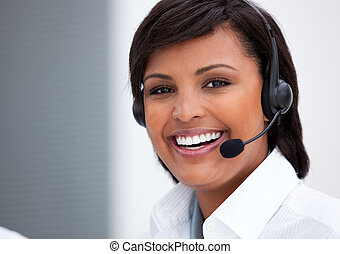Portrait of an ethnic customer service agent at work in the...