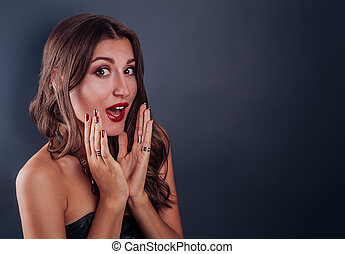 Portrait of an excited beautiful woman