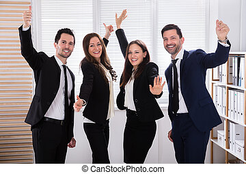 Portrait Of An Excited Businesspeople