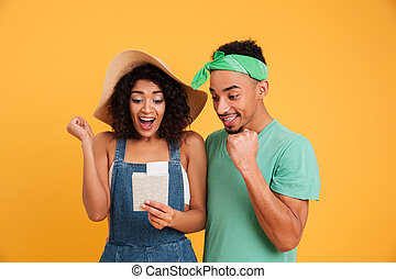 Portrait of an excited young african couple
