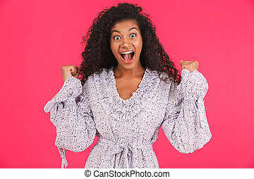 Portrait of an excited young african woman