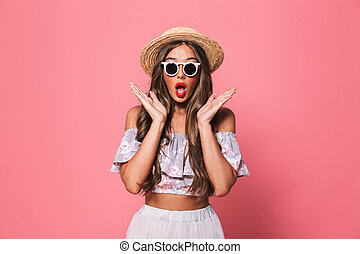 Portrait of an excited young girl in summer clothes