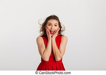 Portrait of an excited young woman