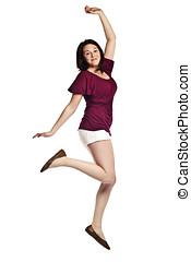 Portrait of an excited young woman jumping
