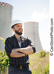 Portrait of an handsome engineer at an electrical station