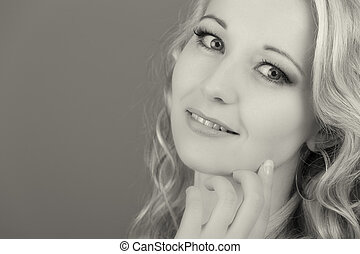 Portrait of an isolated friendly blond woman in high key artistic conversion