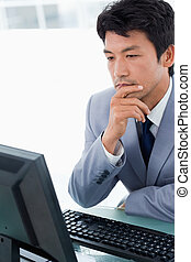 Portrait of an office worker using a monitor
