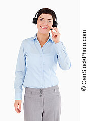 Portrait of an office worker with a headset against a white...