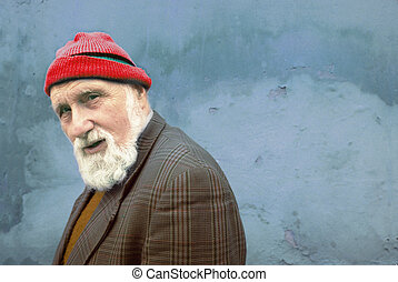 old man - portrait of an old man with the red hat
