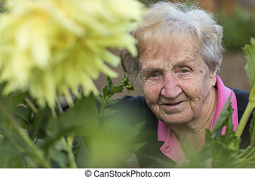 Portrait of an old woman in the gar