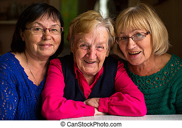 old woman with two adult daughters.