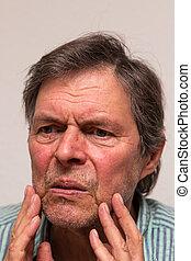 portrait of an unhappy senior