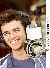 Portrait of an university student recording audio