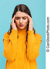 Portrait of an upset young girl in sweater