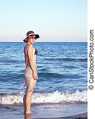 Portrait of an  young woman at the beach.