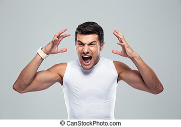 Portrait of angry fitness man shouting