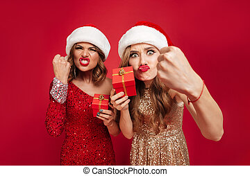 Portrait of angry furious women in christmas hats
