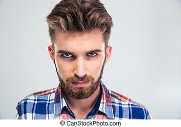 Portrait of angry man looking at camera