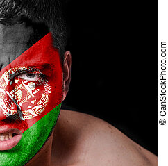 Portrait of angry man with painted flag of Afghanistan